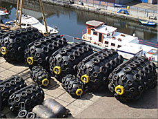 Pneumatic Floating Rubber Fender, type Yokohama. These Yokohama type of Pneumatic Floating Fender is often used Off-Shore in the oil & gas industry as well in the marine construction industry. These Pneumatic Fenders by their floatability and flexibility are used as fenders between ships for transition of oil & gas, chemical products, etc.